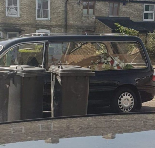 Funeral staff have sparked outrage after they appeared to abandon a coffin in a hearse and go into a cafe for food.The three men were wearing full funeral suits as they headed into a caf? on Milton Road after parking up the hearse, an eyewitness has said.