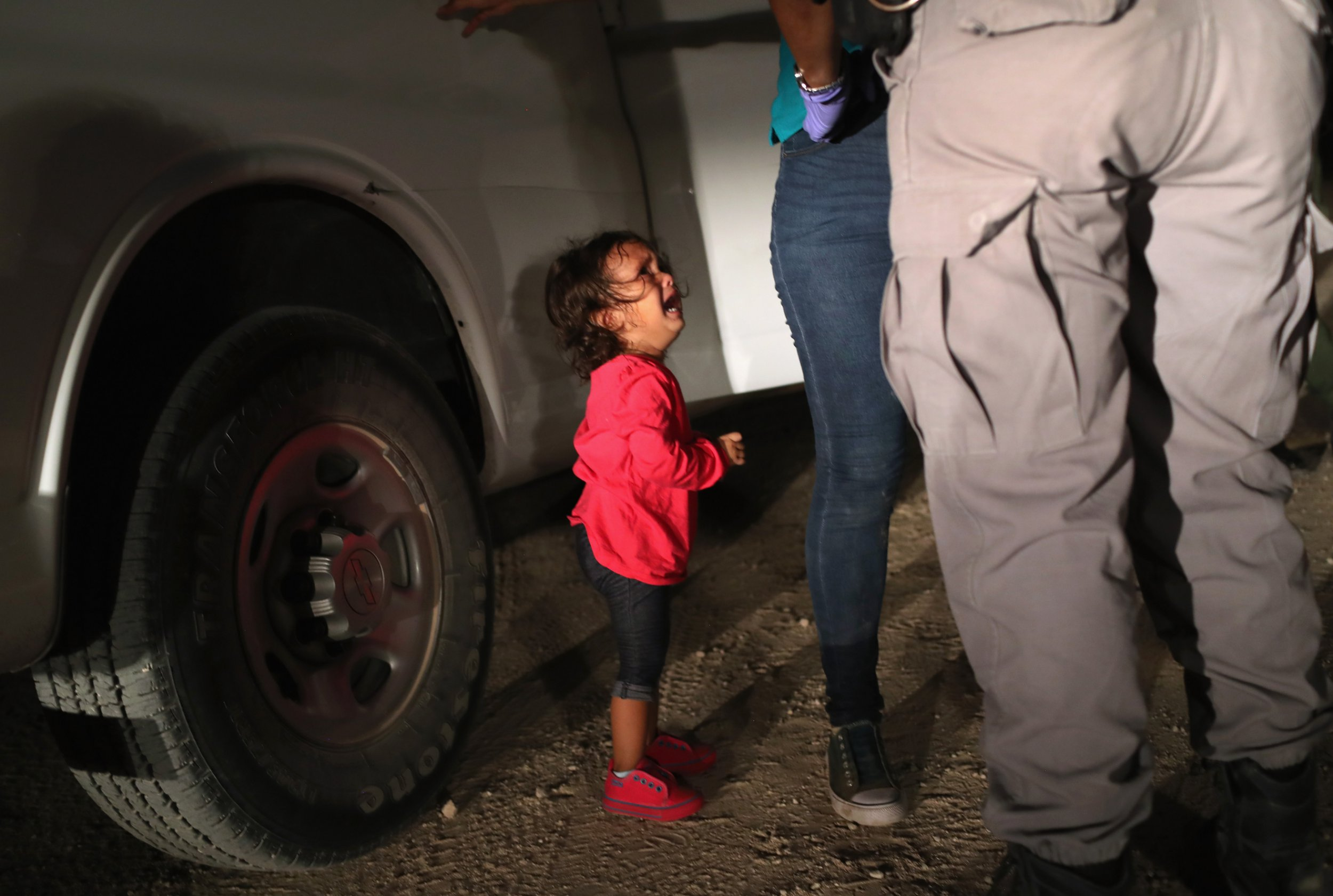 The story behind the heart breaking photograph of a crying child at the US border