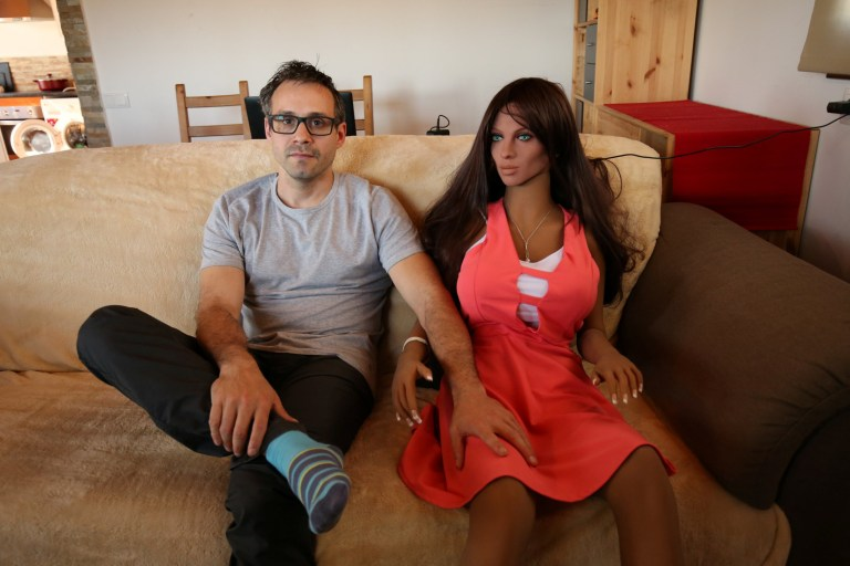 Catalan nanotechnology engineer Sergi Santos poses beside Samantha, a sex doll packed with artificial intelligence providing her the capability to respond to different scenarios and verbal stimulus, in his house in Rubi, north of Barcelona, Spain, March 31, 2017. Picture taken on March 31, 2017. REUTERS/Albert Gea - RC139605E2B0