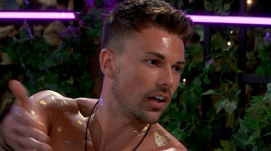 Editorial Use Only. No Merchandising. No Commercial Use. Mandatory Credit: Photo by ITV/REX/Shutterstock (9723837an) New Boy Sam arrives and takes Adam to task 'Love Island' TV Show, Series 4, Episode 17, Majorca, Spain - 21 Jun 2018