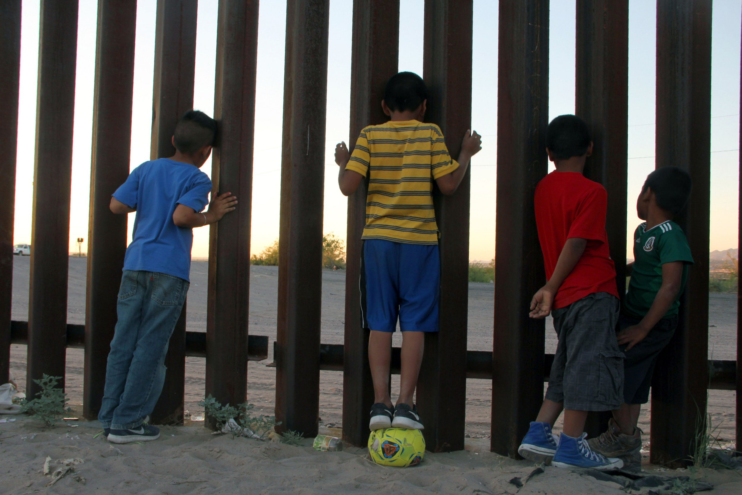 Children look through the border fence outside their home at the Anapra zone between the border of Mexico and the US near Sunland Park, New Mexico, in Ciudad Juarez, Chihuahua State, Mexico, on June 22, 2018. / AFP PHOTO / HERIKA MARTINEZHERIKA MARTINEZ/AFP/Getty Images