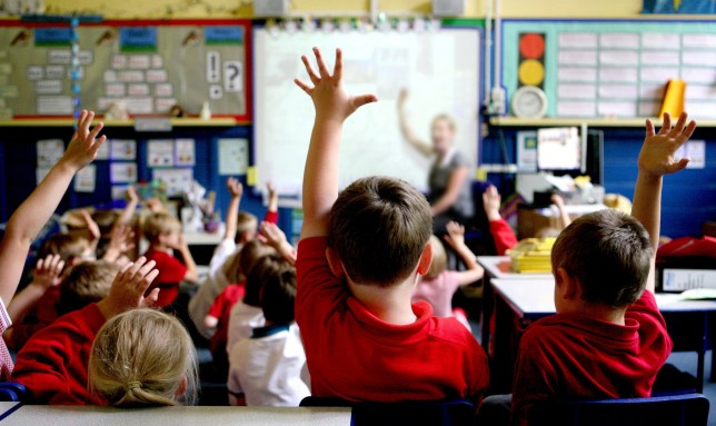 Embargoed to 0001 Thursday April 19 File photo dated 06/07/2011 of children in a classroom, as according to a report many children may be at risk of under-performing in the classroom because they have a limited vocabulary.