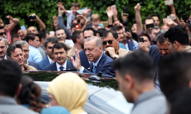 epa06837118 Turkish President Recep Tayyip Erdogan (C) greets his supporters as he leaves after casting his vote for the Turkish presidential and parliamentary elections in Istanbul, Turkey, 24 June 2018. Some 56.3 million registered citizens will vote in snap presidential and parliamentary elections to elect 600 lawmakers and the country's president, the first election since the Turkish people in a referendum in April 2017 voted to change the country's system from a parliamentary to a presidential republic. EPA/ERDEM SAHIN