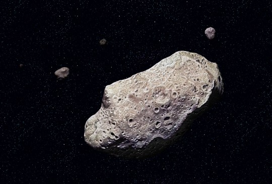 Ida, Ida, discovered by the Galileo probe in 1993, is 52 km long and has a tiny moon, Dactyl. (Photo by: QAI Publishing/UIG via Getty Images)