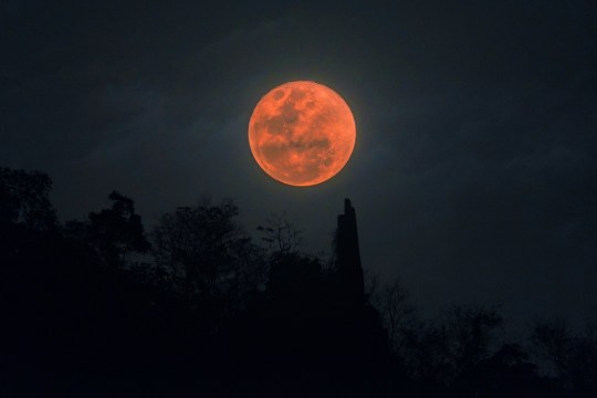 Blood moon full lunar eclipse over mountain in Thailand, Jan 31 2018