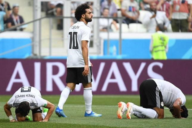 631b34e7cf3 TOPSHOT - Egypt's players react as forward Mohamed Salah (C) scored during  the Russia