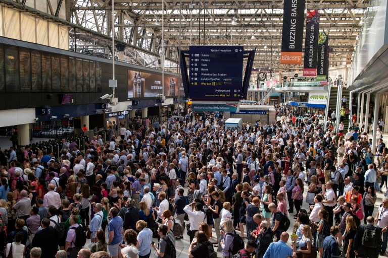 epa06842199 Commuters at Waterloo Station in central London, Britain, 26 June 2018. Train services from Waterloo Station have been affected by high temperatures which have caused speed restrictions on some of the railway network amid concerns that tracks will buckle in the hot conditions. EPA/WILL OLIVER