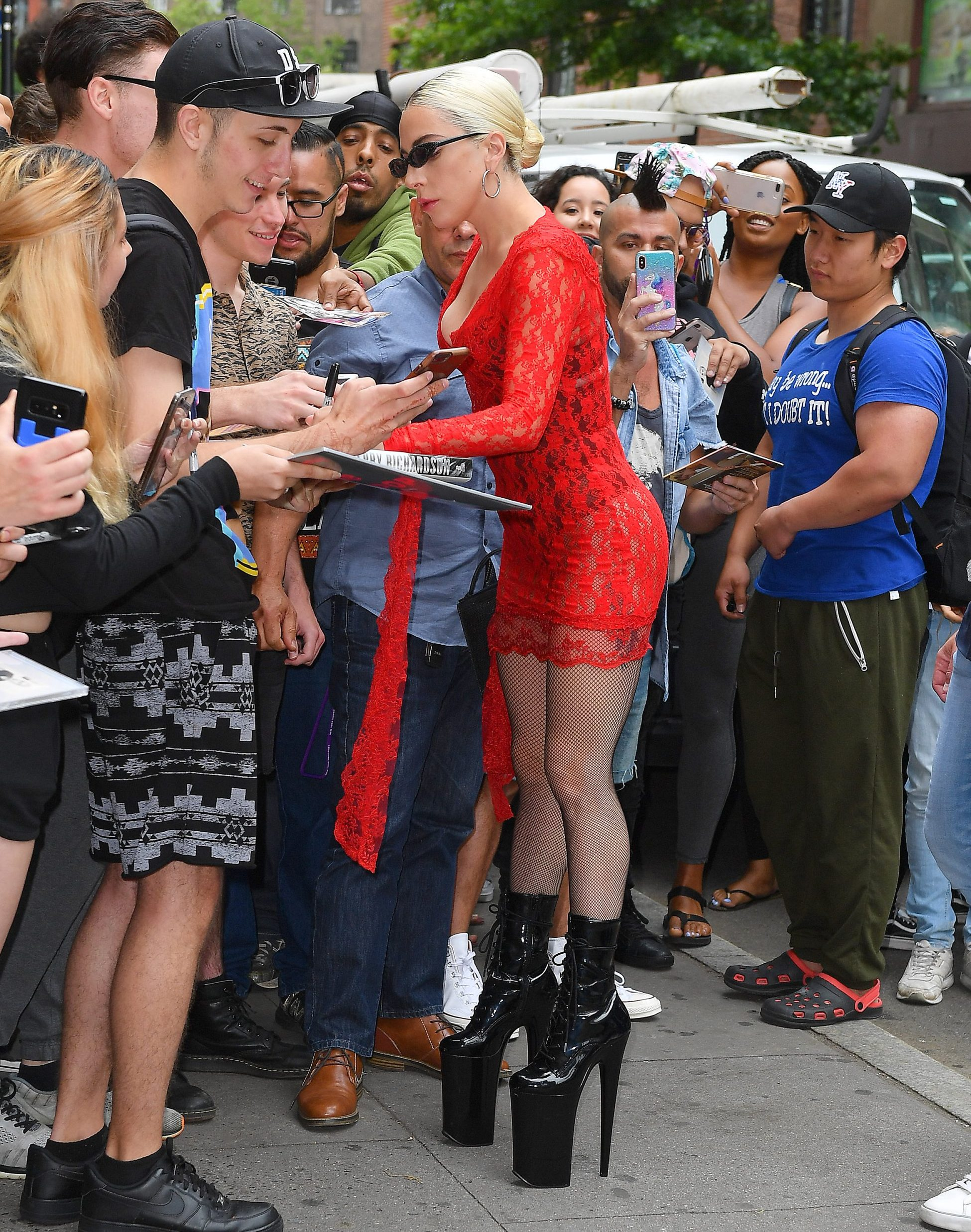 Lady Gaga wears red mesh and greets fans at the studio in New York City Pictured: Lady Gaga Ref: SPL5006839 270618 NON-EXCLUSIVE Picture by: Robert O'neil / SplashNews.com Splash News and Pictures Los Angeles: 310-821-2666 New York: 212-619-2666 London: 0207 644 7656 Milan: +39 02 4399 8577 photodesk@splashnews.com World Rights,
