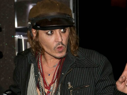 Johnny Depp appears tense as he steps out in Munich amid reports son Jack has 'serious illness'