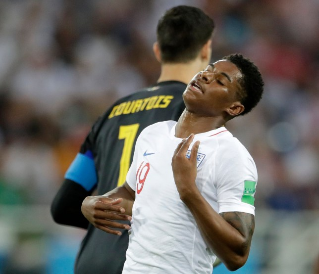 England's Marcus Rashford reacts after Belgium goalkeeper Thibaut Courtois, rear, stopped his shot on goal during the group G match between England and Belgium at the 2018 soccer World Cup in the Kaliningrad Stadium in Kaliningrad, Russia, Thursday, June 28, 2018. (AP Photo/Petr David Josek)