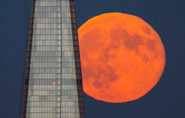 ? Licensed to London News Pictures. 28/06/2018. London, UK. A spectacular full moon known as a strawberry moon rises behind the Shard skyscraper after another hot summer day in the capital. Photo credit: Peter Macdiarmid/LNP