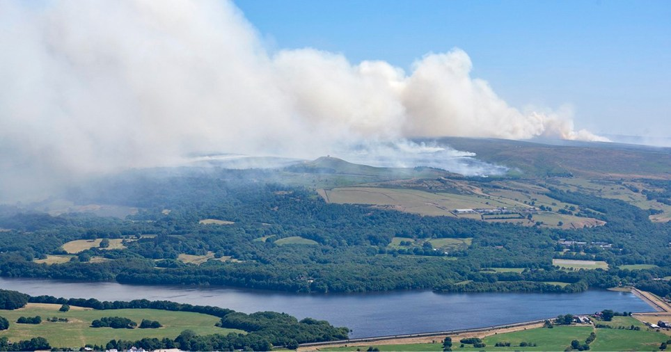 Scorched landscape of Winter Hill, north of Bolton. The police and fire service have launched a joint investigation into the cause of the blaze on Winter Hill in Lancashire, which emergency crews have been battling to stop spreading since Thursday. A 22-year-old from Bolton has been held on suspicion of arson with intent to endanger life.