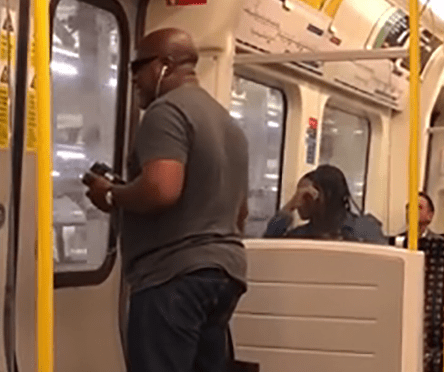 Moment headphone-wearing commuter belts out Deep Purple classic on London tube... and doesn't care who hears him