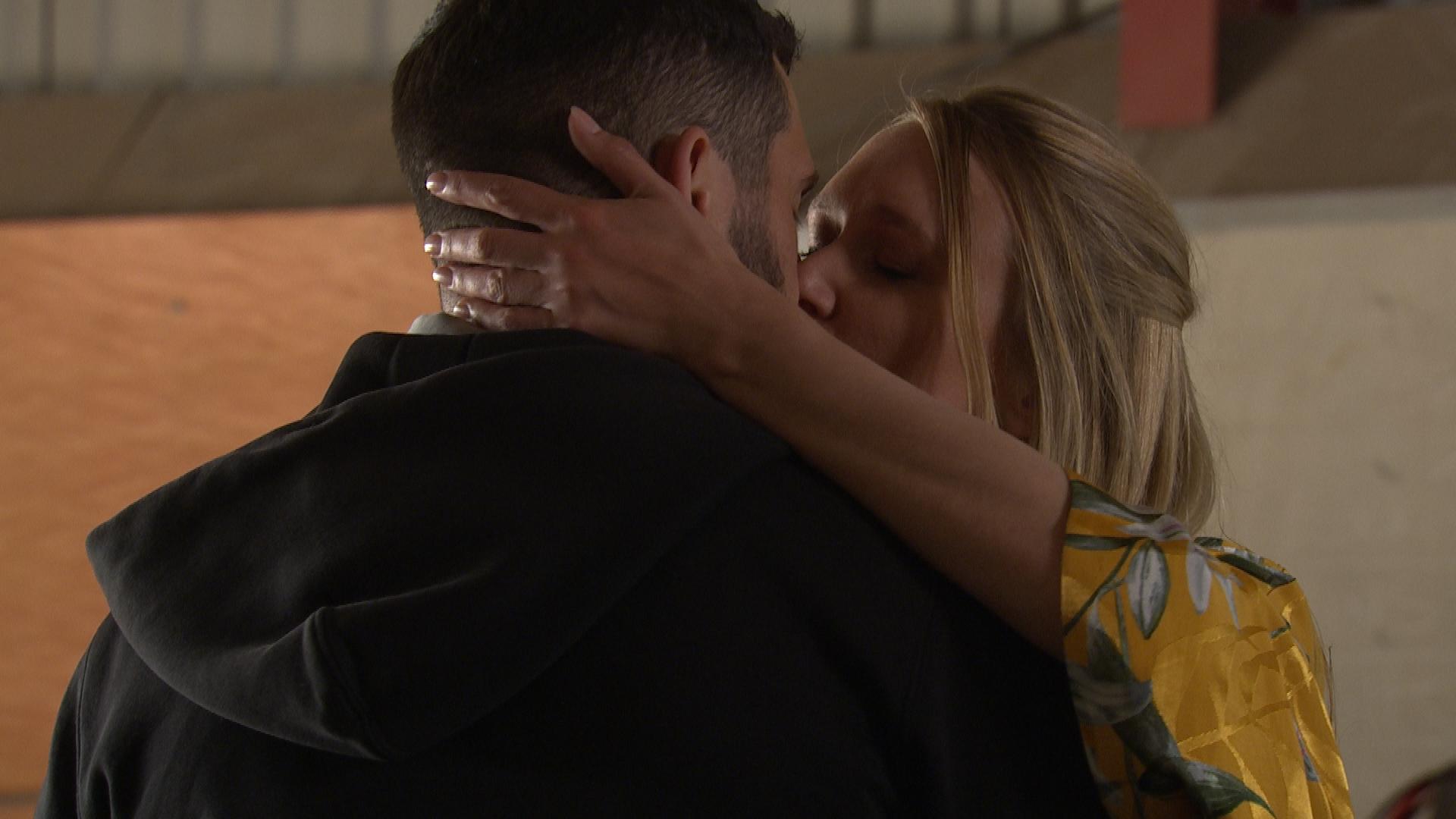 Rebecca kisses Ross in Emmerdale