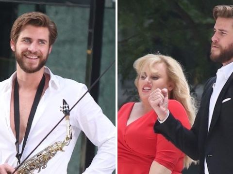Liam Hemsworth and Rebel Wilson get their jive on while filming Isn't It Romantic