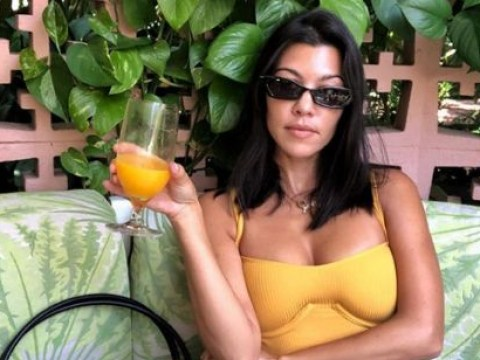 Kourtney Kardashian shows how extra she is as she orders drink to match her dress