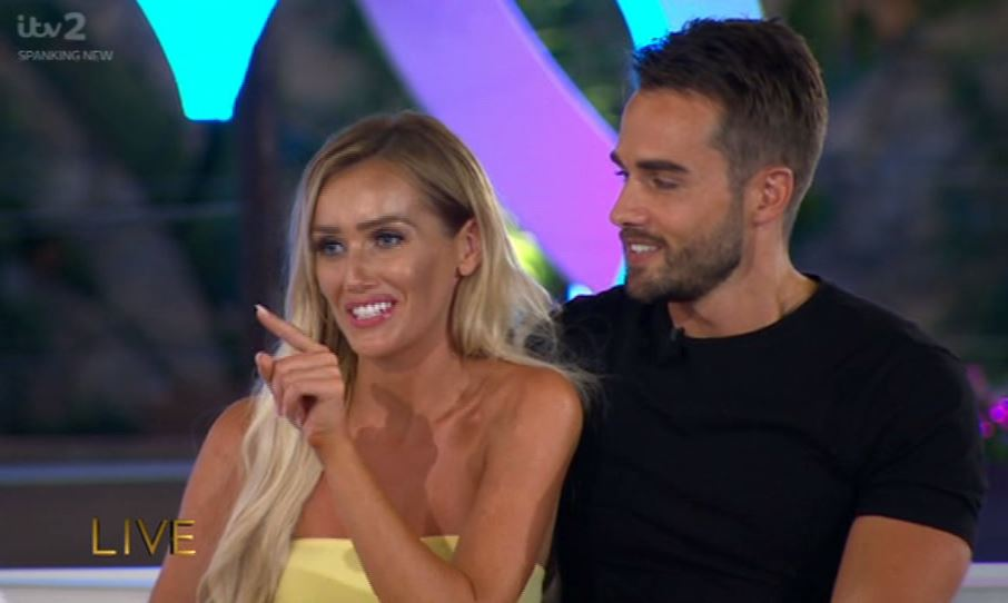 Love Island's Laura Anderson gives Caroline Flack back chat as the host tells her 'don't rush things'