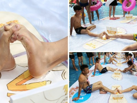 Bizarre toe-wrestling contest held in China to 'stop swimmers getting cramp'