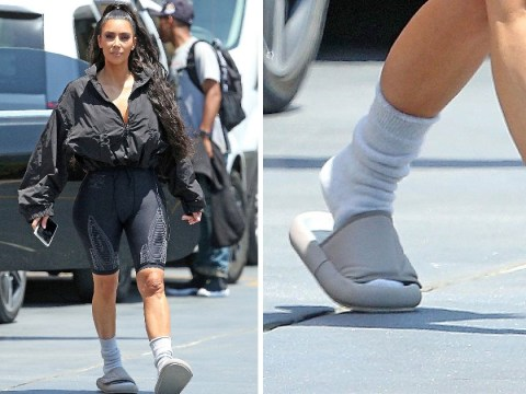 Kim Kardashian determined to make socks and slides happen as she heads to pop-up diner