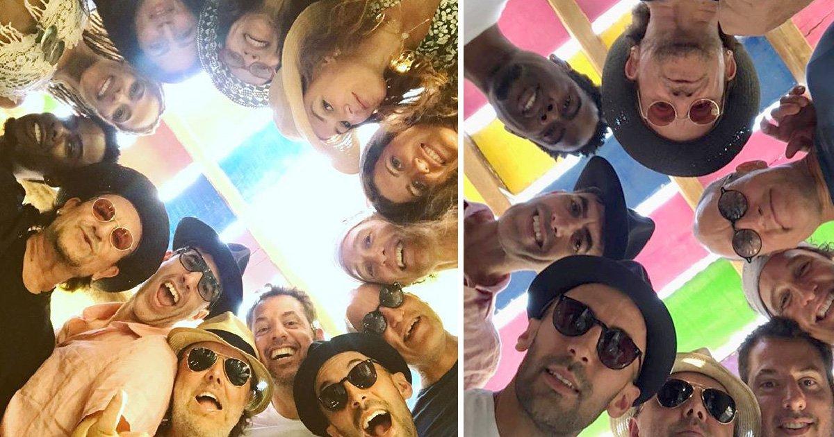 Epic holiday selfie brings Bono, Chris Rock, Sacha Baron Cohen, Woody Harrelson and Matthew McConaughey together