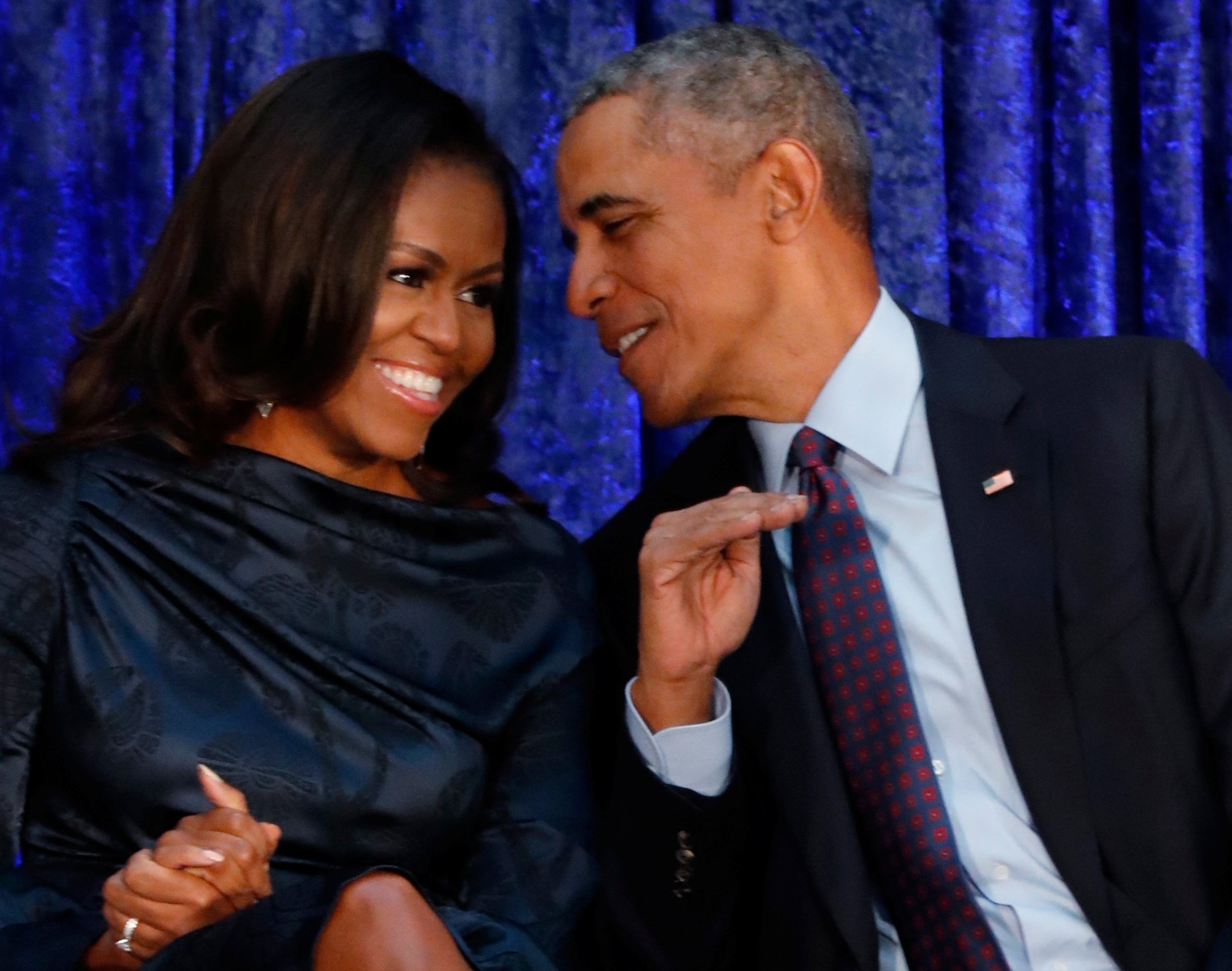 FILE PHOTO: Former U.S. President Barack Obama sits with former first lady Michelle Obama prior to the the unveiling of their portraits at the Smithsonian???s National Portrait Gallery in Washington, DC, U.S., February 12, 2018. REUTERS/Jim Bourg/File Photo