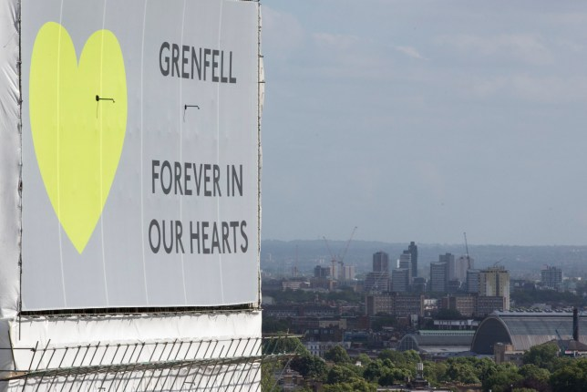 Grenfell Tower, now covered in plastic sheeting, one year since the blaze, which claimed 72 lives. PRESS ASSOCIATION Photo. Picture date: Thursday June 14, 2018. Thursday marks 12 months since a small kitchen fire in the high-rise turned into the most deadly domestic blaze since the Second World War. See PA story MEMORIAL Grenfell. Photo credit should read: Rick Findler/PA Wire
