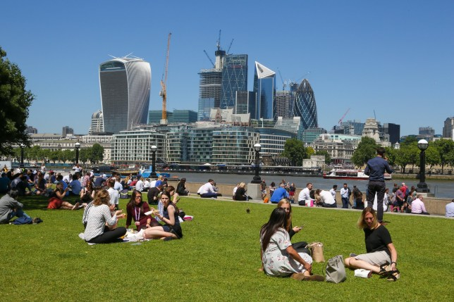 City workers enjoy hot weather on Potters Fields near Tower Bridge. Dry and hot weather continues in Britain as temperatures are expected to reach 33??C later this week. Featuring: Atmosphere, View Where: London, United Kingdom When: 27 Jun 2018 Credit: Dinendra Haria/WENN