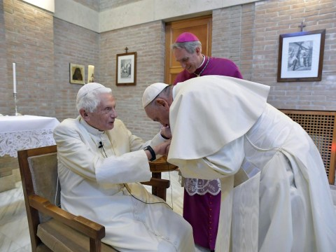 Pope Benedict makes rare public appearance as Pope Francis lays hands on him