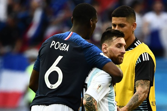 France's midfielder Paul Pogba (L) consoles Argentina's forward Lionel Messi (C) during the Russia 2018 World Cup round of 16 football match between France and Argentina at the Kazan Arena in Kazan on June 30, 2018. / AFP PHOTO / Jewel SAMAD / RESTRICTED TO EDITORIAL USE - NO MOBILE PUSH ALERTS/DOWNLOADSJEWEL SAMAD/AFP/Getty Images