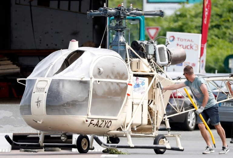 epa06855505 Investigators transport an Alouette II helicopter allegedly abandoned by French prisoner Redoine Faid and suspected accomplices after his escape from the prison of Reau, in Gonesse, north of Paris, France, 01 July 2018. According to news reports citing police sources, Redoine Faid, who served a 25 year sentence, has allegedly escaped from the prison of Reau, Seine-et-Marne, onboard a helicopter. EPA/IAN LANGSDON