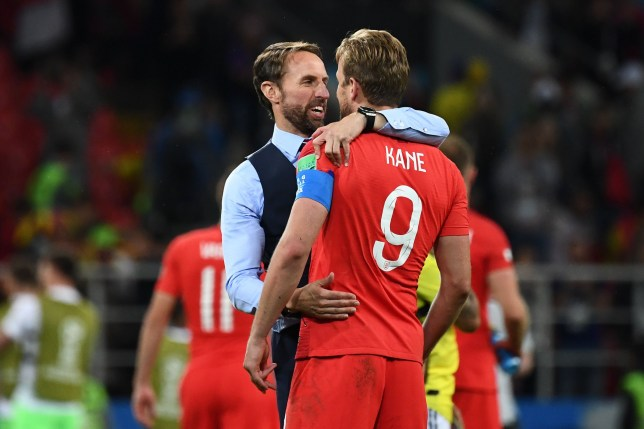 England's forward Harry Kane (R) is congratulated by England's coach Gareth Southgate (L) as they celebrate after winning at the end of to the Russia 2018 World Cup round of 16 football match between Colombia and England at the Spartak Stadium in Moscow on July 3, 2018. / AFP PHOTO / FRANCK FIFE / RESTRICTED TO EDITORIAL USE - NO MOBILE PUSH ALERTS/DOWNLOADSFRANCK FIFE/AFP/Getty Images