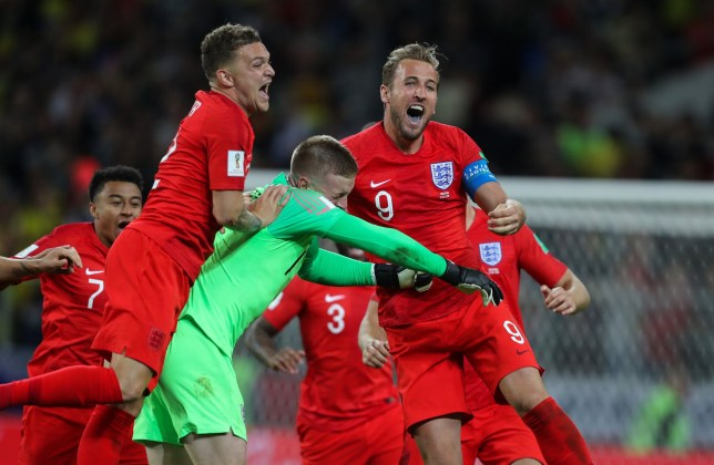 MOSCOW, RUSSIA - JULY 03: Kieran Trippier of England Jordan Pickford of England Harry Kane of England celebrates victory in a penalty shoot out during the 2018 FIFA World Cup Russia Round of 16 match between Colombia and England at Spartak Stadium on July 3, 2018 in Moscow, Russia. (Photo by Stefan Matzke - sampics/Corbis via Getty Images)