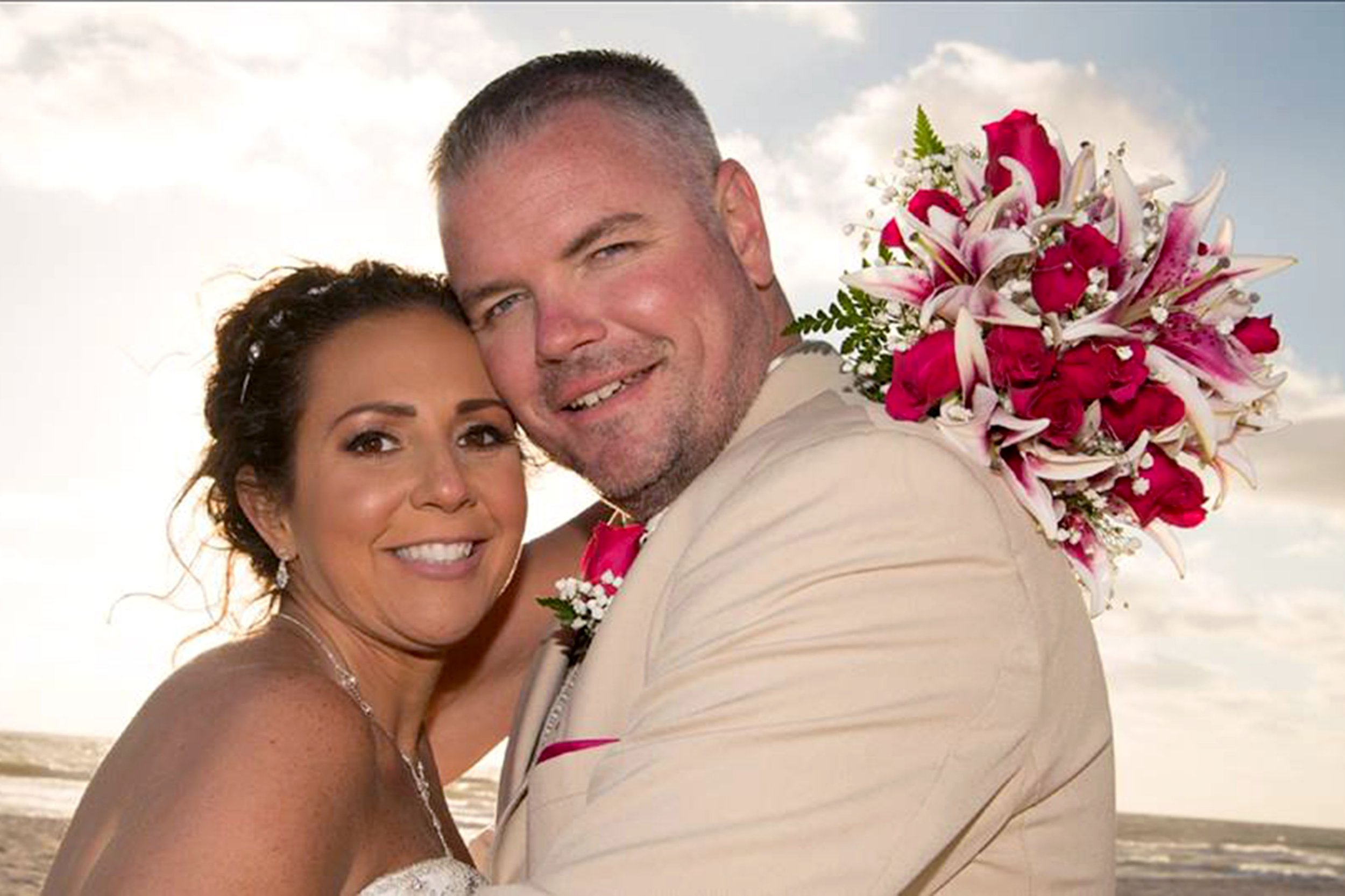PIC FROM Karen Buono / Caters News - (PICTURED: Karen Buono with her partner John on their wedding day in April 2018) - A woman who finally lost her virginity at 32 has opened up about the rare condition that meant she could never have penetrative sex because it was like hitting a brick wall.Karen Buono, 35, spent most of her life suffering from a painful condition called vaginismus which meant she was never able to insert a tampon, have a pap smear or engage in penetrative sex.SEE CATERS COPY