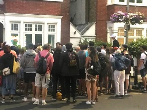 Wimbledon fans crowd round stranger's window to watch England match on their way home