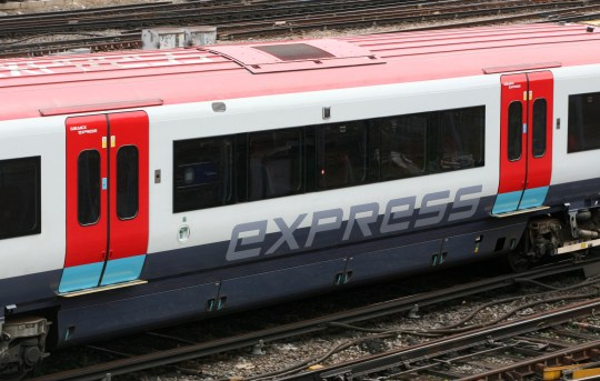 A Gatwick Express train on the approach into London Victoria station.