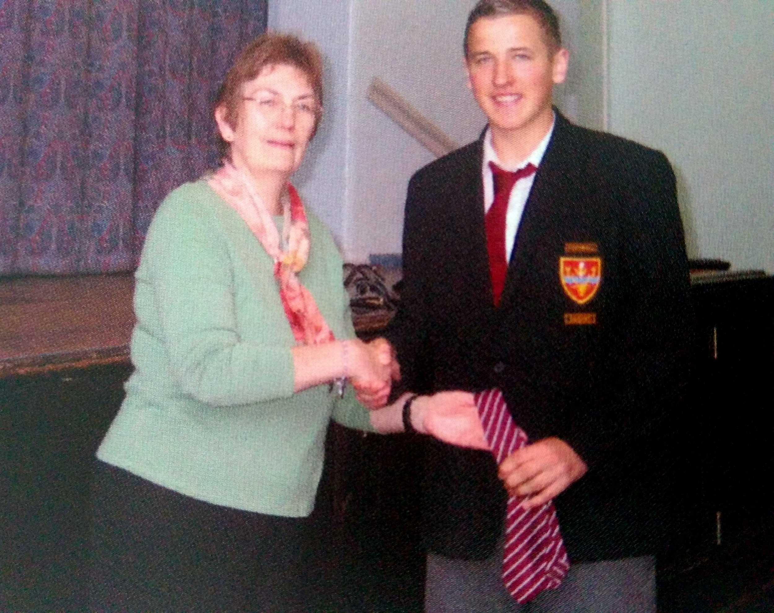 Harry Kane is seen in a school photo with his school tie. See SWNS story SWKANE; Fans are hoping Harry Kane will soon be recreating this never-before-seen yearbook photo of him lifting the cup surrounded by his football team - aged just 15. The photo shows the fresh-faced teenager posing for pics with the Year 11 football team at Chingford Foundation School in the London Borough Waltham Forest. The 2004-2009 yearbook also includes snaps of him accepting a striped tie for his dedication to the football and cricket teams while shaking hands with his head of year. And it wasn't just Harry who was good at sport according to the yearbook.