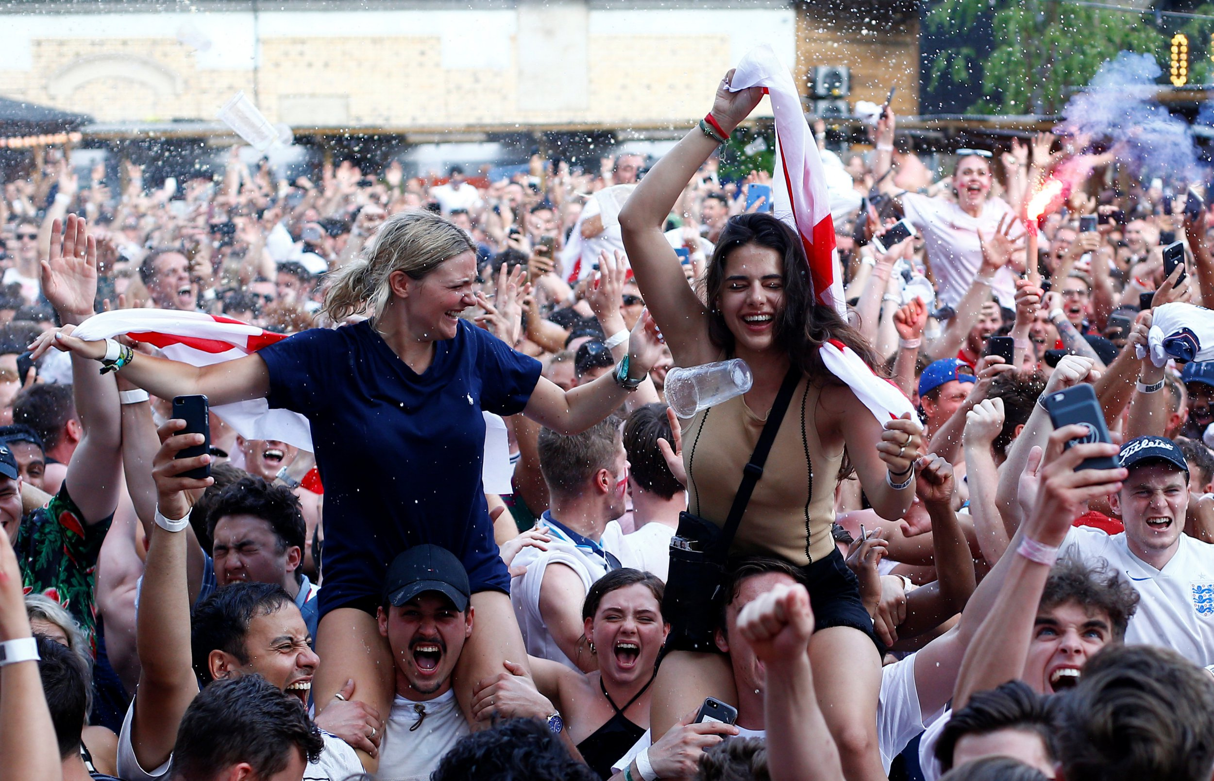 Soccer Football - World Cup - England fans watch Sweden vs England - Flat Iron Square, London, Britain - July 7, 2018 England fans celebrate at the end of the match REUTERS/Henry Nicholls