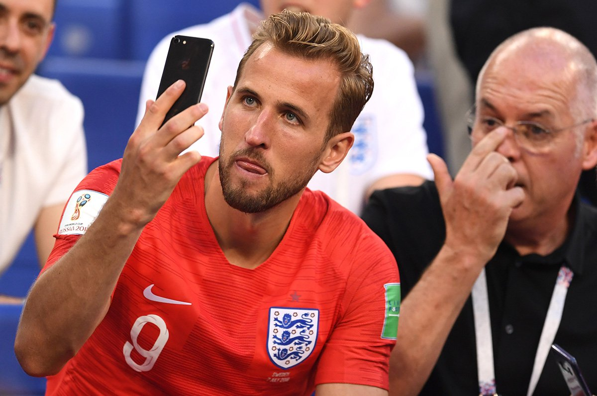 SAMARA, RUSSIA - JULY 07: Harry Kane of England watches his phone following his sides victory in the 2018 FIFA World Cup Russia Quarter Final match between Sweden and England at Samara Arena on July 7, 2018 in Samara, Russia. (Photo by David Ramos - FIFA/FIFA via Getty Images)