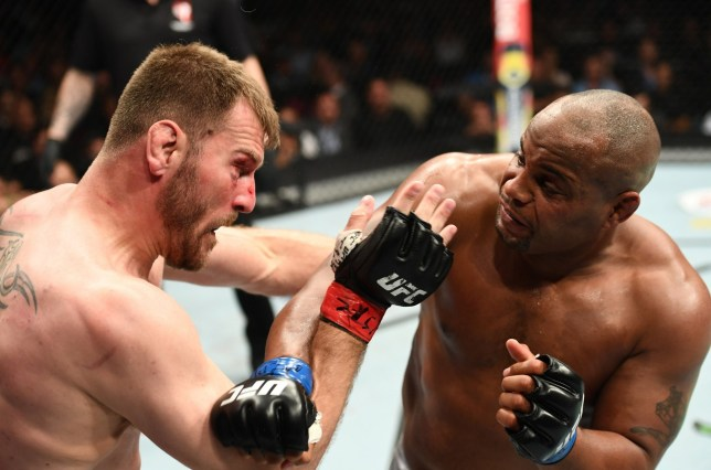 LAS VEGAS, NV - JULY 07: Daniel Cormier punches Stipe Miocic in their UFC heavyweight championship fight during the UFC 226 event inside T-Mobile Arena on July 7, 2018 in Las Vegas, Nevada. (Photo by Josh Hedges/Zuffa LLC/Zuffa LLC via Getty Images)