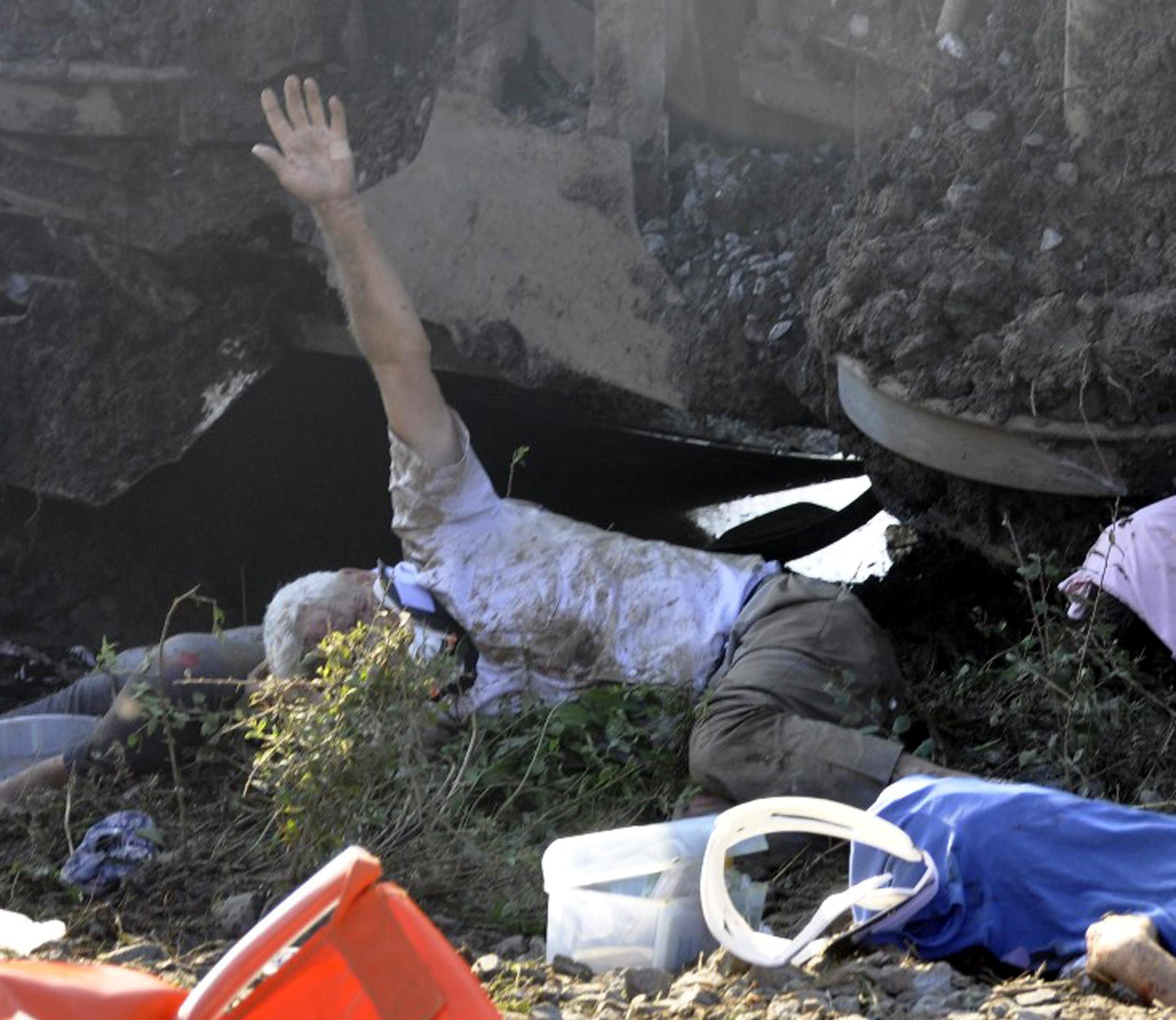 ABACA Press via Press Association Images. GRAPHIC CONTENT - Emergency services rescue victims from overturned train cars near a village in Tekirdag province, Turkey Sunday, July 8, 2018. At least 10 people were killed and more than 70 injured Sunday when multiple cars of a train derailed in western Turkey, a Turkish official said. Photo by Depo Photos/ABACAPRESS.COM