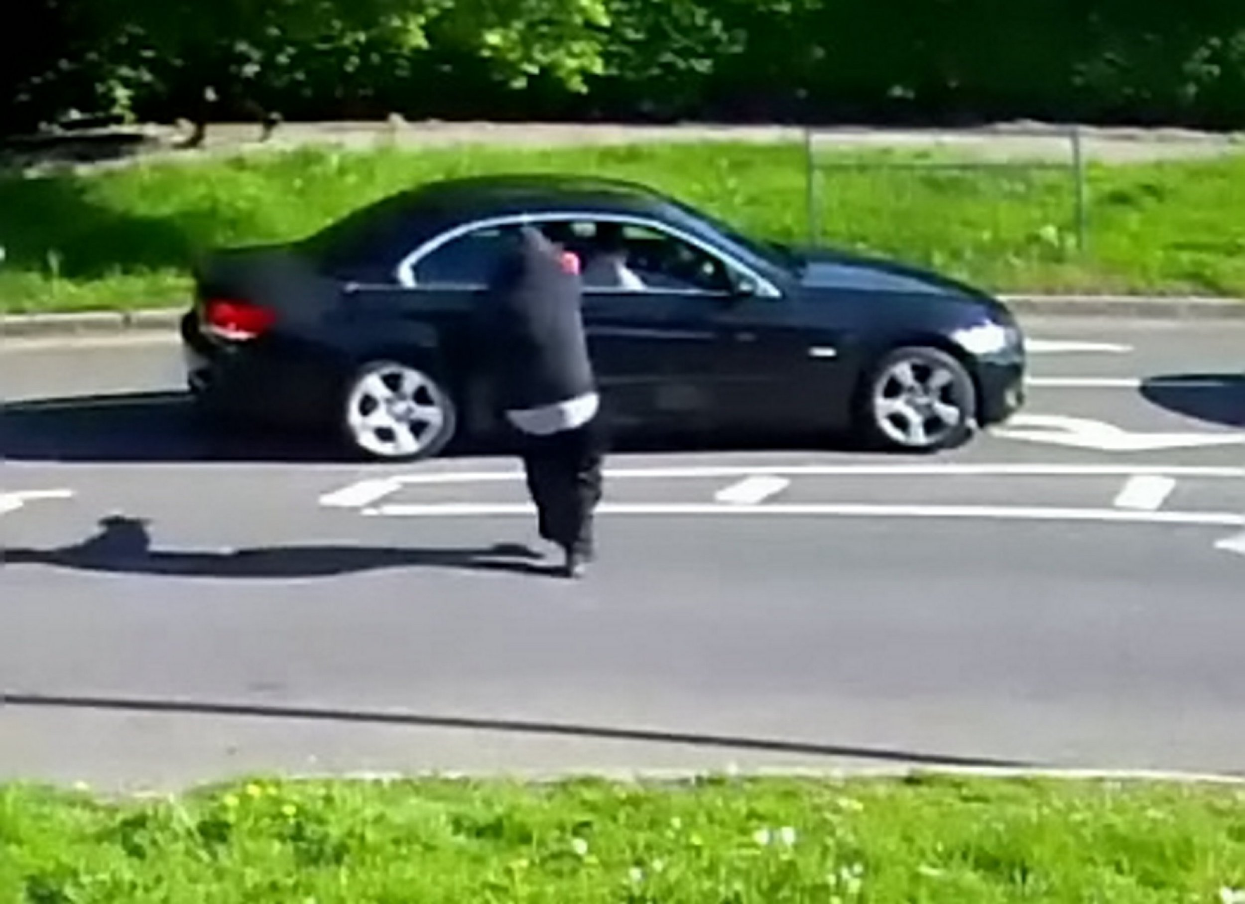 Detectives have released CCTV footage of an attempted murder as they appeal for witnesses to the shooting. See NATIONAL story NNSHOOT. Police were called at 08:40hrs on Monday, 14 May to reports of a shooting at the junction of Beverley Drive and Stag Lane in Brent. Officers and firearms officers attended the scene, along with a specialist police dog, to speak to the victim and contain the scene. The victim, a 51-year-old woman, told officers that she had left her home at around 08:30hrs to make her way to work. At the traffic lights on Beverley Drive and Stag Lane the suspect approached the car and fired three times towards her vehicle. The driver?s window smashed first and the victim remembers hearing two other shots being fired into her car. One of the bullets caused the passenger window to smash. She was not injured. Three bullet casings were found at the scene. The suspect then ran down the road before getting into an unknown vehicle, heading in the direction of Queensbury Station.