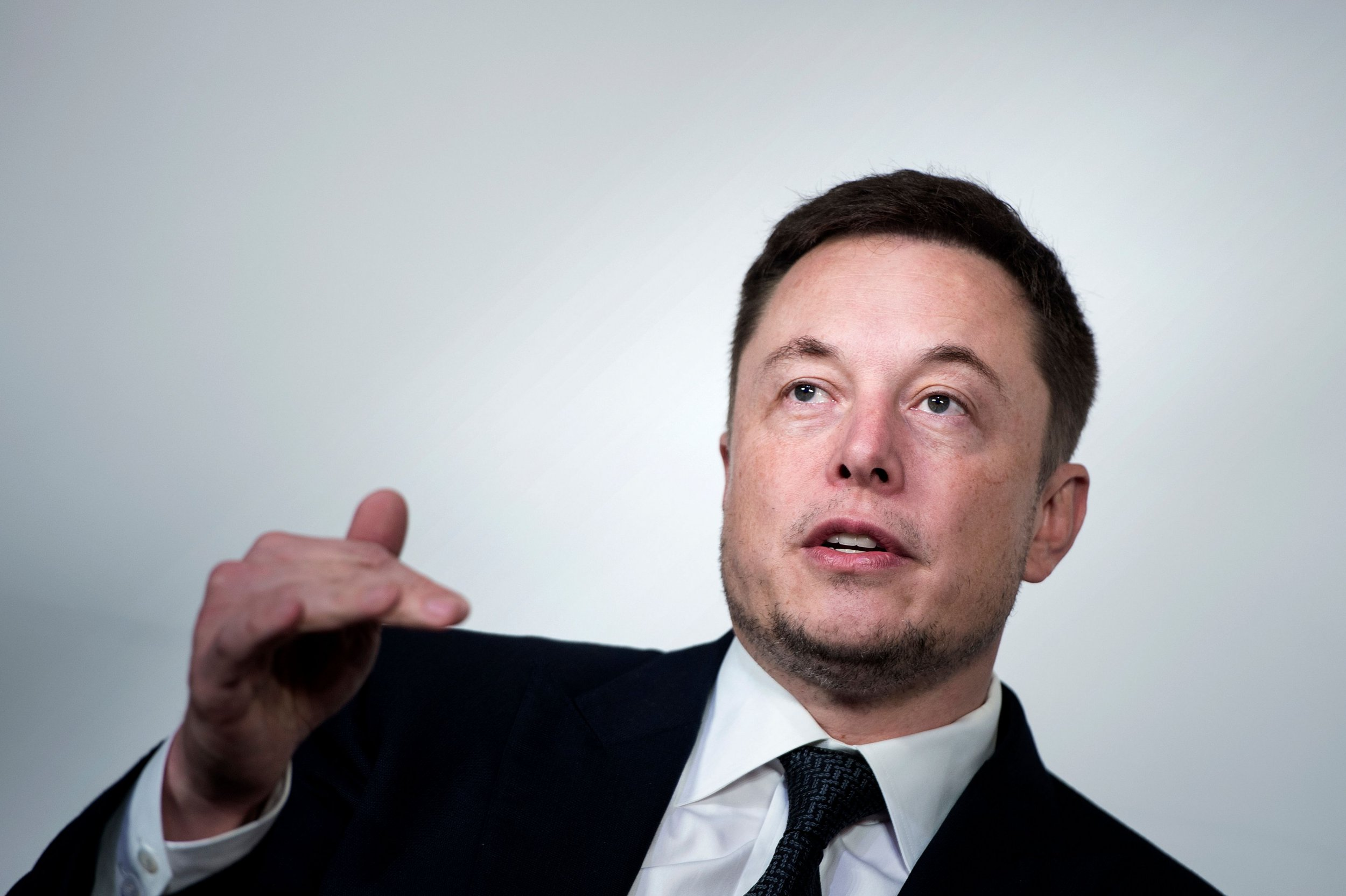 (FILES) In this file photo taken on July 19, 2017, Elon Musk, CEO of SpaceX and Tesla, speaks during the International Space Station Research and Development Conference at the Omni Shoreham Hotel in Washington, DC. American space entrepreneur Elon Musk tweeted that he was in Thailand on Tuesday July 8, 2018, with a prototype mini-sub, at the flooded cave where five members of a youth football team remained trapped. / AFP PHOTO / Brendan Smialowski BRENDAN SMIALOWSKI/AFP/Getty Images