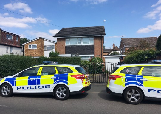 """Police at the property on Loop Street, Woking where 84-year-old Joyce Burgess lived. A kindly pensioner savagely battered and left to die in her home may have offered her killer a glass of water in the heatwave, according to horrified neighbours. See National story NNMURDER. Police say the Joyce Burgess - described as a """"lovely, sweet and kind lady"""" - was the victim of a violent burglary less than a hour after England's World Cup win over Sweden on Saturday afternoon. The 84-year-old was rushed to hospital with severe injuries from her detached house in Woking, Surrey. But a murder inquiry was launched after she lost her fight for life earlier today (TUES). Neighbours were told by police the suspect may have asked Joyce for a glass of water so he could gain access to her home in Loop Road."""