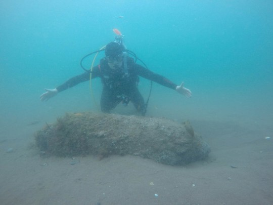 A 600kg World War Two bomb has been discovered by the Luftwaffe under a pier in Teignmouth, Devon. See SWNS story SWBOMB; This is the moment a scuba diver discovered a 1200kg bomb dropped by the Luftwaffe - just under a pier at a popular beach. James Cunningham, 19, came across the device when diving with his uncle on Monday evening. Having first thought the huge object was a container, a closer inspection led to him realising that it was in fact far more dangerous. Mr Cunningham said they then quickly swam to the surface and contacted the authorities.
