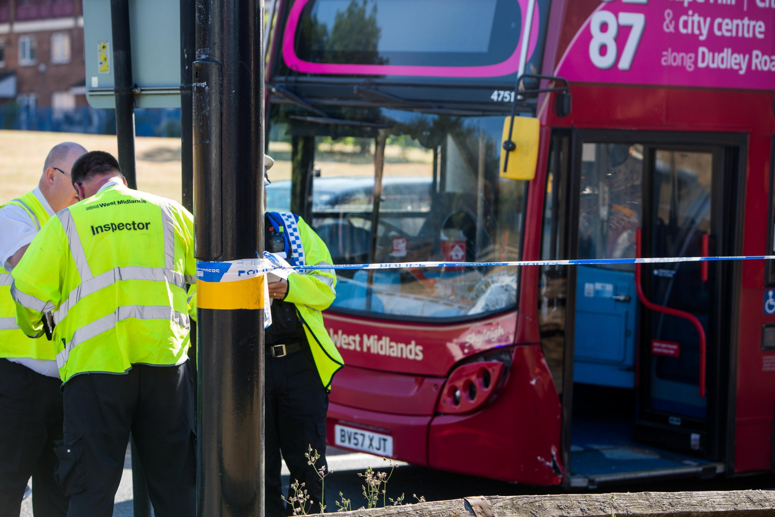 "Police at the scene of a serious collision at Spring Hill, Winson Green Birmingham after two school children were hit by a bus just after 4.20pm today 10 July 2018. See NTI story NTIHIT. Two schoolchildren have been rushed to hospital after being hit by a bus in a city suburb this afternoon (Tue). Emergency services rushed to the junction of Camden Street and Ellen Street in Winson Green, Birmingham at around 4.20pm. Both boys were taken to hospital and one of the youngsters was described as having a ""serious head injury."" Roads were cordoned off while emergency crews made the area safe causing rush-hour traffic chaos across the city."