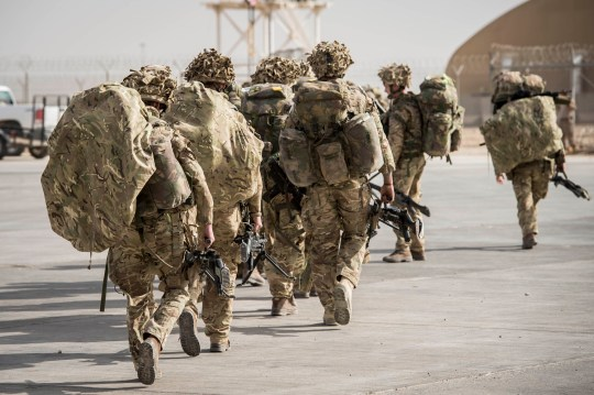 Some of the last British troops head towards the flight line as they prepare to leave Camp Bastion, Helmand Province, Afghanistan, as UK and Coalition forces carry out their Tactical Withdrawal finally leaving the base and handing it over to Afghan National Army.