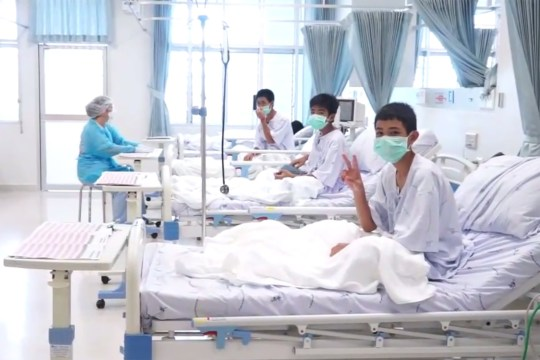 """This handout video grab taken from footage released by The Thai government public relations department (PRD) and Government spokesman bureau on July 11, 2018 shows members of the """"Wild Boars"""" football team being treated at a hospital in Chiang Rai. The 12 boys rescued from a Thai cave were passed """"sleeping"""" on stretchers through the treacherous passageways, a former Thai Navy SEAL told AFP on July 11, giving the first clear details of an astonishing rescue mission that has captivated the world. / AFP PHOTO / Thai government public relations department (PRD) AND Government spokesman bureau / Handout / RESTRICTED TO EDITORIAL USE - MANDATORY CREDIT """"AFP PHOTO / The government public relations department (PRD) and Government spokesman bureau """" - NO MARKETING NO ADVERTISING CAMPAIGNS - DISTRIBUTED AS A SERVICE TO CLIENTSHANDOUT/AFP/Getty Images"""