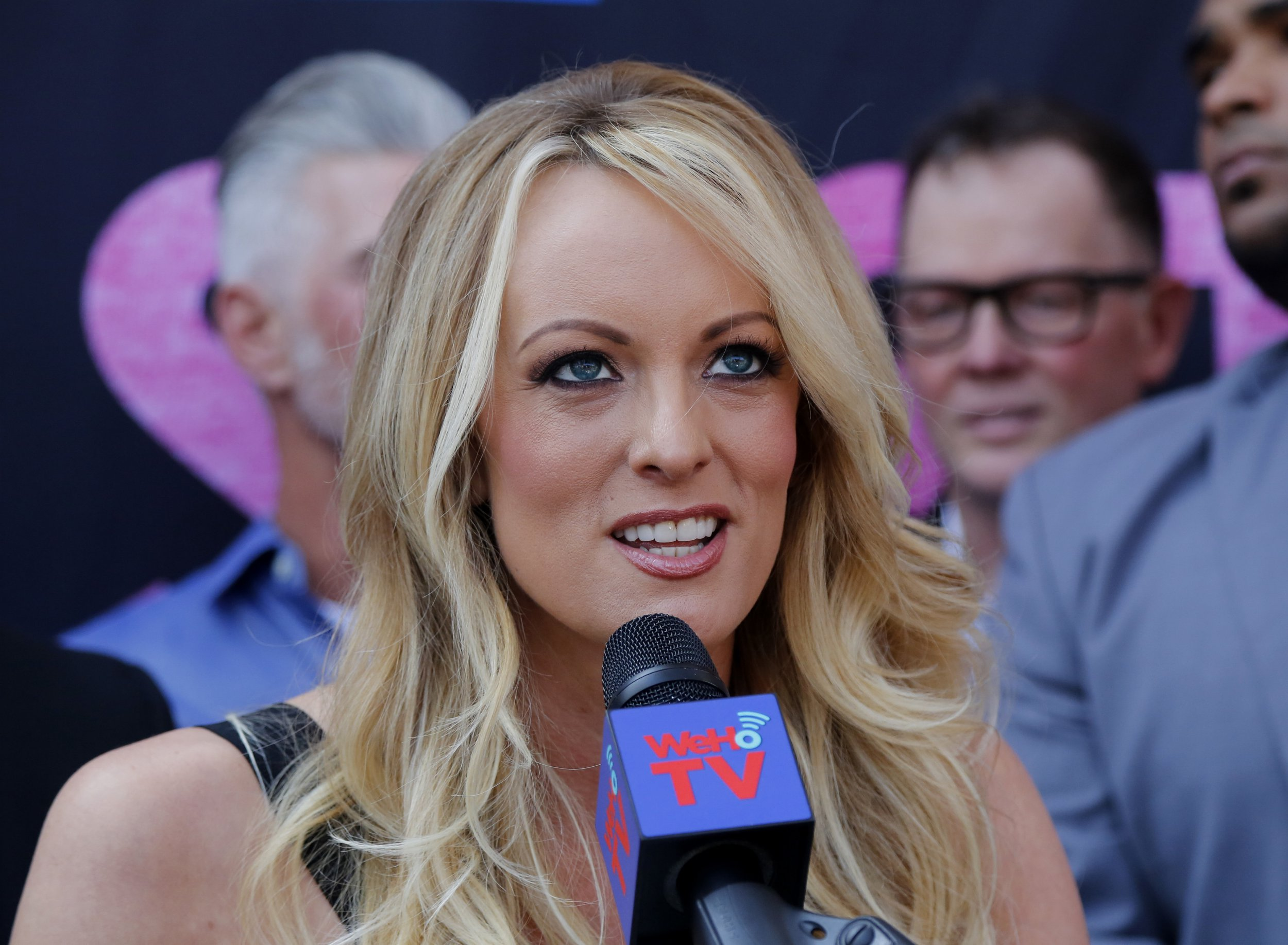 FILE - In this May 23, 2018 file photo, porn actress Stormy Daniels speaks during a ceremony for her receiving a City Proclamation and Key to the City in West Hollywood, Calif. Daniels was arrested at an Ohio strip club and is accused of letting patrons touch her in violation of a state law, her attorney said early Thursday, July 12. While Daniels was performing at Sirens, a strip club in Columbus, some patrons touched her in a ???non-sexual??? way, her lawyer, Michael Avenatti, told The Associated Press. An Ohio law known as the Community Defense Act prohibits anyone who isn???t a family member to touch a nude or semi-nude dancer. (AP Photo/Ringo H.W. Chiu, File)