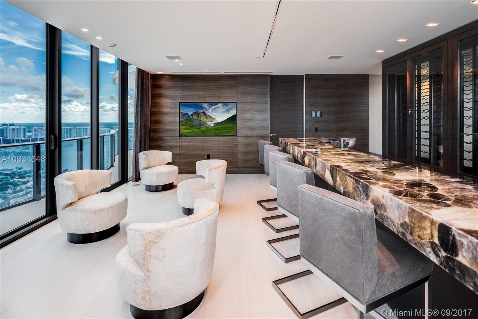 The buyer of a $36 million penthouse which has a $1 million-dollar bathroom will receive a $500,000 rare pink diamond as gift for purchasing it??? The triplex apartment is at the top of the 46-storey Regalia luxury tower in Sunny Isles Beach, Florida. The 10,755-square-foot property has six bedrooms, six full bathrooms and three partial bathrooms. There???s a huge living room featuring a cantilevered stone staircase and a dazzling chandelier with 225-plus floating glass pendants. The ???Entertainment Wing??? has an 1,100-square-foot game room and a movie theatre. The kitchen features cabinets custom designed and manufactured in Italy. On the second level, the master bedroom suite takes up the entire north eastern side of the building. Its $1 million dollar 1,500-square-foot bathroom features a large steam room and sauna, a hydrotherapy Jacuzzi tub and a towel-warming wall. A private glass elevator goes from floor to floor. On the rooftop, there???s a bar and cascading waterfall into a private pool. There is also a separate living and kitchen area designated for guests and staff quarters. Outside, there???s a 360-degree terrace on the first floor, a 270-degree terrace on the second level and a private pool, summer barbecue and 360-degree wrap-around terraces on the top floor. ***** TNI Press Ltd does not hold or assert any Copyright or License in the attached image. Any fees paid to TNI are for TNI???s services only. Such fee does not, nor is it intended to, convey to the user any Copyright or License in the image. By publishing this image, the user expressly agrees to indemnify TNI against any claims, demands, or causes of action arising from, or connected in any way, with the user's publication of the image.