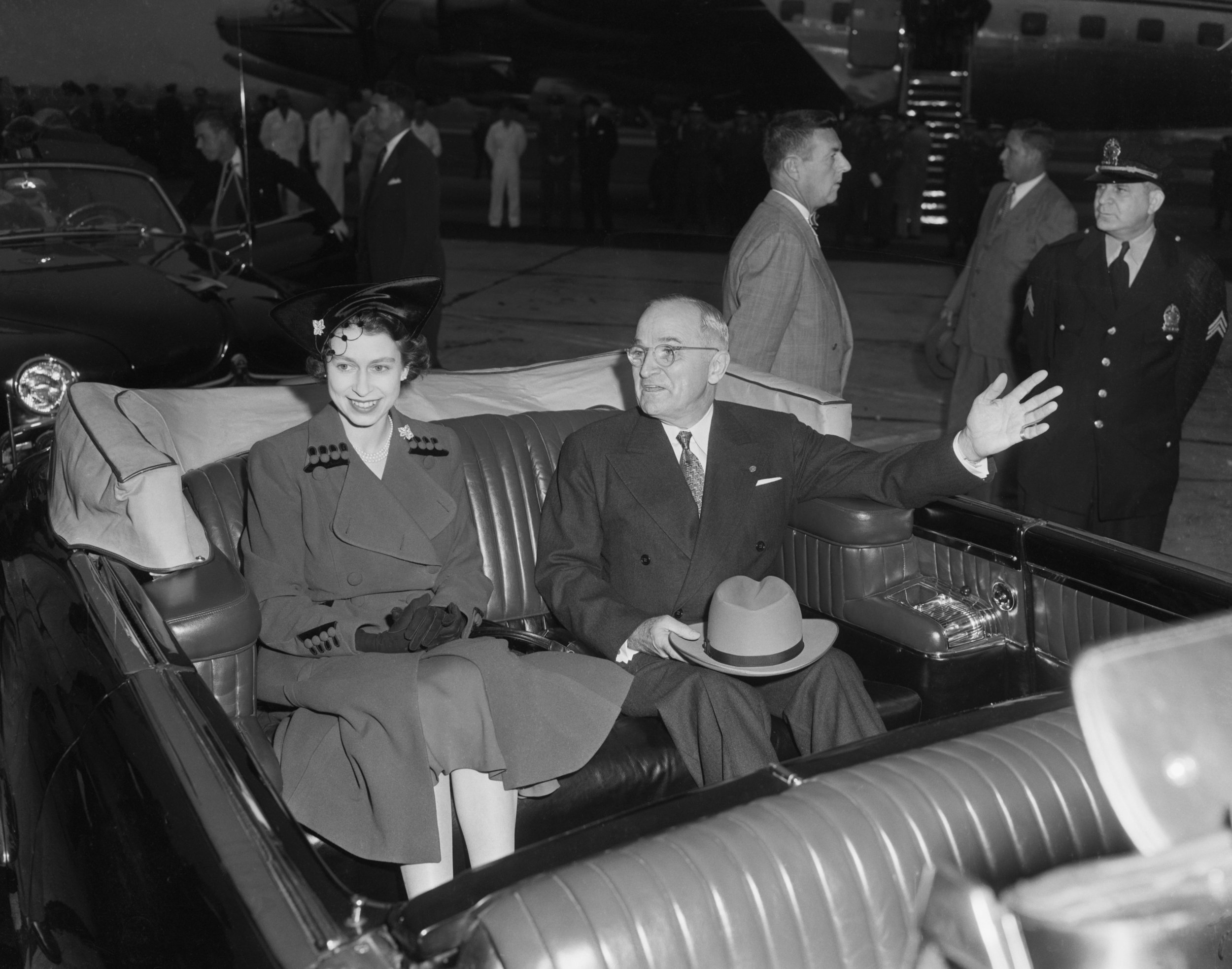 """(Original Caption) 10/31/1951-Washington, D.C.: President Harry S. Truman and Britain's Princess Elizabeth are shown as their motorcade got underway following the reception ceremony at Washington National Airport today. The Chief Executive welcomed Elizabeth and her husband, Prince Philip, Duke of Edinburgh, with the warm hope that """"when you leave you will like us even better than when you came."""""""